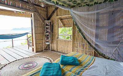 Mumbo Island thatched unit overlooking Lake Malawi. ©TO