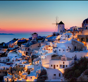 Sunset in Santorini, Greece. Photo via Flickr:Pedro Szekely