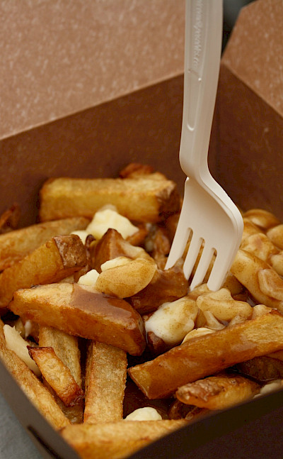"""Poutine"" (fries with gravy & curd) in Canada! Flickr:Danielle Scott"