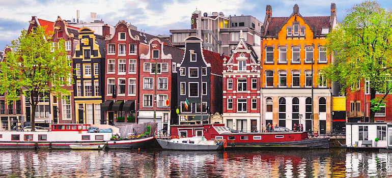 Row houses and canals in Amsterdam, North Holland, the Netherlands.