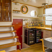 Bar area in the dining room aboard the Allure | Bike & Boat Tours