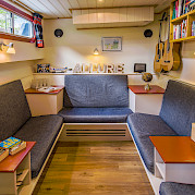 Cozy library and seating area aboard the Allure | Bike & Boat Tours