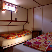 Twin bed cabin - Wending | Bike & Boat Tours