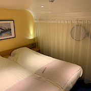Double bed setting aboard the Merlijn - Bike & Boat Tours
