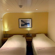 Twin bed setting aboard the Merlijn - Bike & Boat Tours