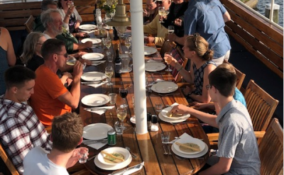 Enjoying a meal on deck | Zwaan | Bike & Boat Tours