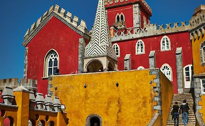 The Romanticist Pena Palace that sits atop Sintra Mountain along the Portuguese Riviera. Flickr:Luca Sartoni