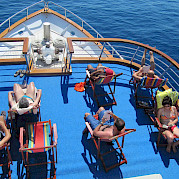 Sunning and relaxing on the Romantica | Bike & Boat Tours