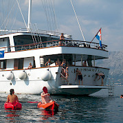 Swimming off Romantica | Bike & Boat Tours