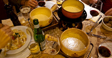 Cheese fondue is a favorite in Switzerland. Photo via Flickr:John Mettraux