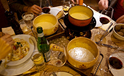 Cheese fondue is a favorite in Switzerland. Flickr:John Mettraux