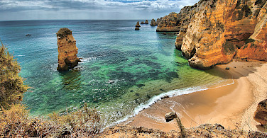 Cliffs and beaches of Algarve, Portugal. Photo via Flickr:Oliver Clarke