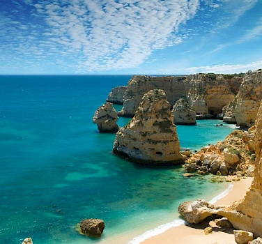 Cliffs of Lagos, Algarve, Portugal. Photo via Wikimedia Commons:Ricard12