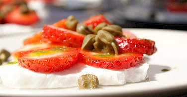 Cycling fuel - fresh Portuguese cheese with strawberries. Photo via Flickr:Marijke Blazer