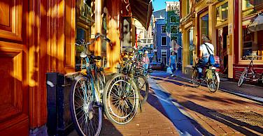 Biking through Amsterdam, North Holland. Photo via Flickr:Moyan Brenn