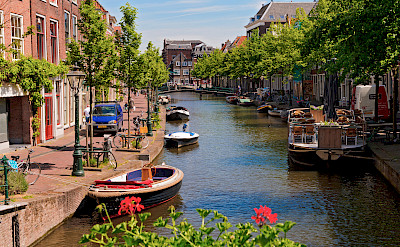 Cycling along the canal in Leiden, South Holland. Flickr:Tambako the Jaguar