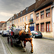 Carriage ride in Bruges, West Flanders, Belgium. Photo via Flickr:Wolfgang Staudt