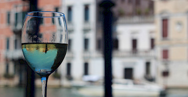 Great Italian wine along the canals in Venice, Italy. Photo via Flickr:Matt B