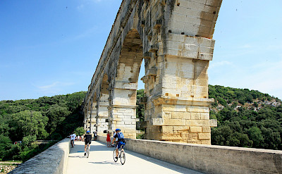 Biking along Pont du Gard, the famous Roman aqueduct in Provence, France. Flickr:Andrea Schaffer
