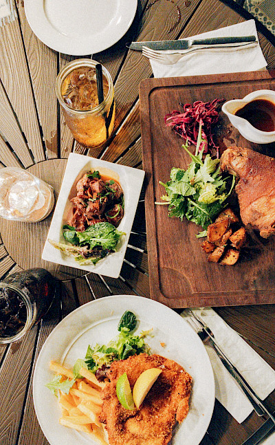 Don't forget to try the schnitzel and German food! Photo by Shawn Ang on Unsplash
