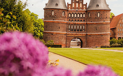 Holstentor is a old city gate into Lübeck, Germany, the ancient Hanseatic Town. Photo by Julia Solonina on Unsplash