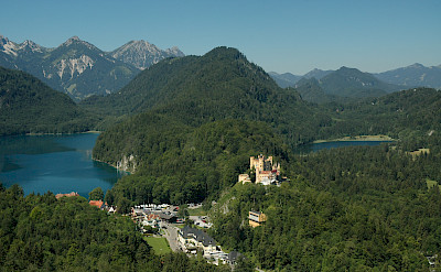 Hohenschwangau village and Castle as viewed from Neuschwanstein Castle, Germany. Photo via Wikimedia Commons:Abelson