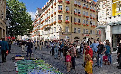 Kaufingerstrasse street art on Marienplatz in Munich, Germany. Photo via Wikimedia Commons: David Iliff