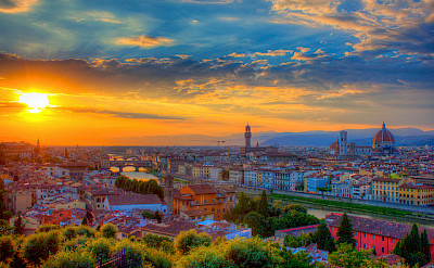 Florence at sunset with the Ponte Vecchio Bridge in Tuscany, Italy. Photo via Flickr:Jiuguang Wang