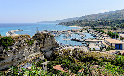 Harbor in Tropea, Calabria, southern Italy. Photo via Wikimedia Commons:Norbert Nagel