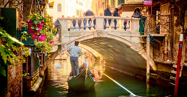 Romantic cruise in Venice, Veneto, Italy. Photo via Flickr:Moyan Brenn