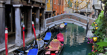 Gondolas await in Venice, Veneto, Italy. Photo via Flickr:gnuckx