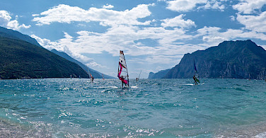 Windsurfers on Lake Garda, Italy. Photo via Flickr:Andrea Santoni