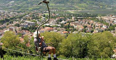Chair lift over Merano, South Tyrol, Italy. Photo via Flickr:Leo-seta