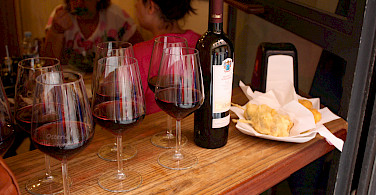 Wine tasting at an osteria. Photo via Flickr:Mark Doliner