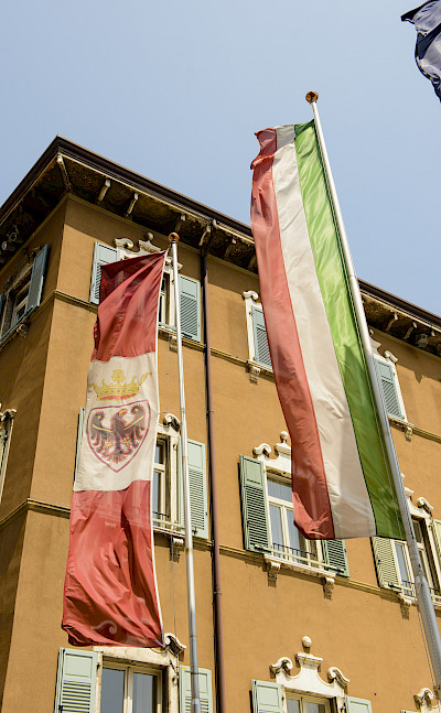 Flags of Italy and Trentino in Riva del Garda, Italy. Photo via Flickr:Son of Groucho