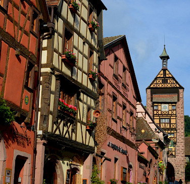 Colorful streets in Riquewihr in Alsace, France. Photo via Flickr:Pug Girl