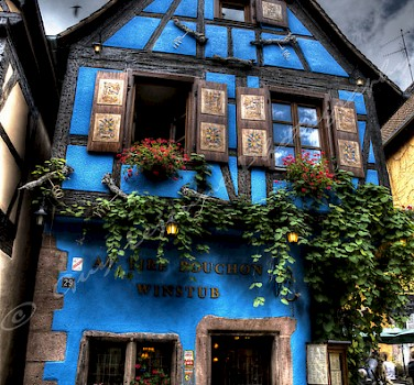 Blue house in Riquewihr, France. Photo via Flickr:Guy Lejeune