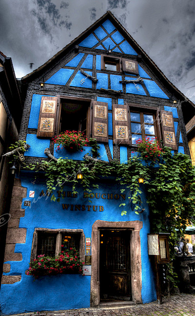 Blue house in Riquewihr, France. Flickr:Guy Lejeune