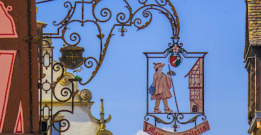 Decorative signs in Colmar, Alsace, France. Photo via Flickr:Kiefer