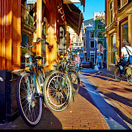 Biking through Amsterdam, North Holland, the Netherlands. Photo via Flickr:Moyan Brenn