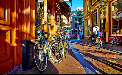 Biking through Amsterdam, North Holland, the Netherlands. Flickr:Moyan Brenn