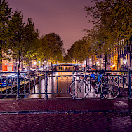 Nighttime in Amsterdam, North Holland, the Netherlands. Photo via Flickr:Syuqoraizzat