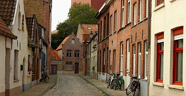 Cobblestone streets in Bruges, West Flanders, Belgium. Photo via Flickr:Elroy Serrao