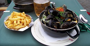 Moules Frite, a typical Belgian lunch of mussels and fries. Photo via Flickr:Colin Cameron