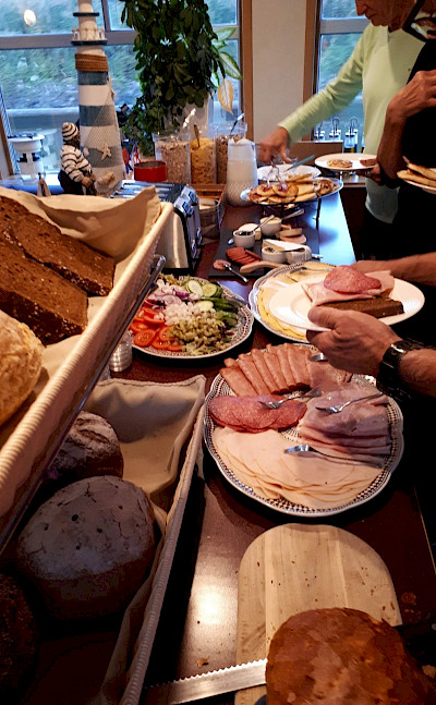 Breakfast spread on this Paris to Bruges tour through France and Belgium. Photo by Eric Darwin