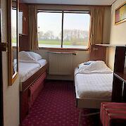 Poseidon - Twin bed cabin cabin window