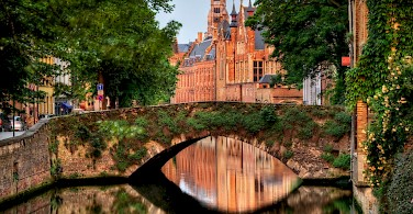 Take a canal tour in Bruges, Belgium. Photo via Wikimedia Commons:Wolfgang Staudt