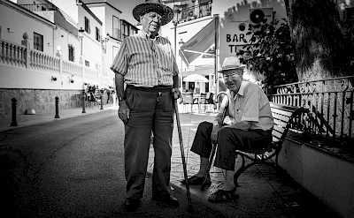 Two old men in an ancient town in Andalusia, Spain. Photo by Wiebrig Krakau on Unsplash