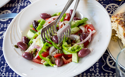 Traditional Greek food on board ship. Cyclades Islands Greece bike tour.
