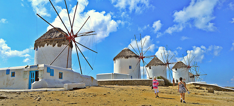 Famous windmills above Mykonos on Mykonos Island, Greece. Photo via Flickr:Ira Gelb